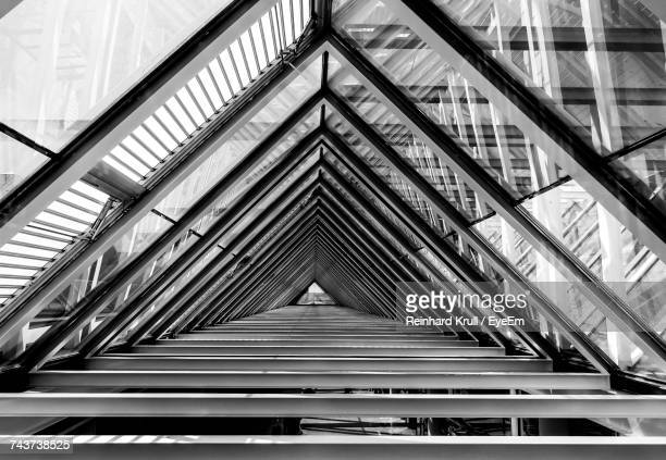 diminishing view of glass roof in modern building - triangle stock photos and pictures