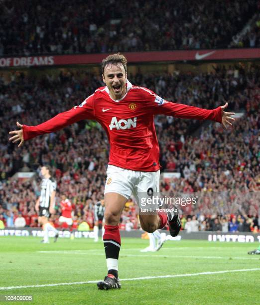 Dimitar Berbatov celebrates after he scored the opening goal during the Barclays Premier League match between Manchester United and Newcastle United...