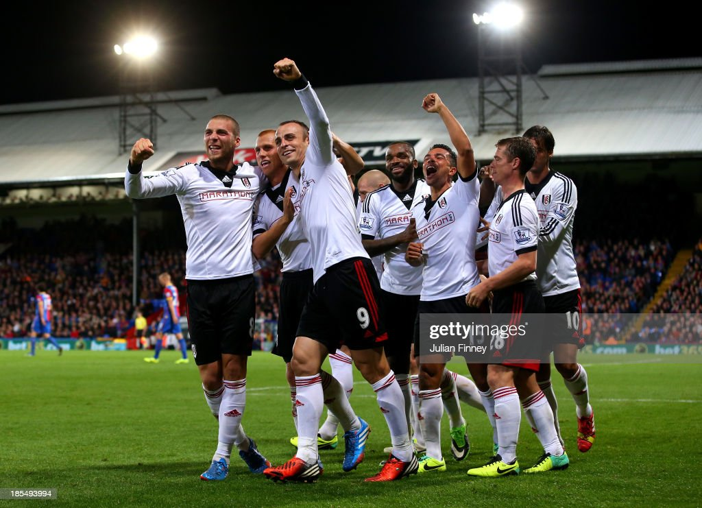 Dimitar Berbatov #9 of Fulham celebrates with teammates after scoring his team's third goal during the Barclays Premier League match between Crystal Palace and Fulham at Selhurst Park on October 21, 2013 in London, England.