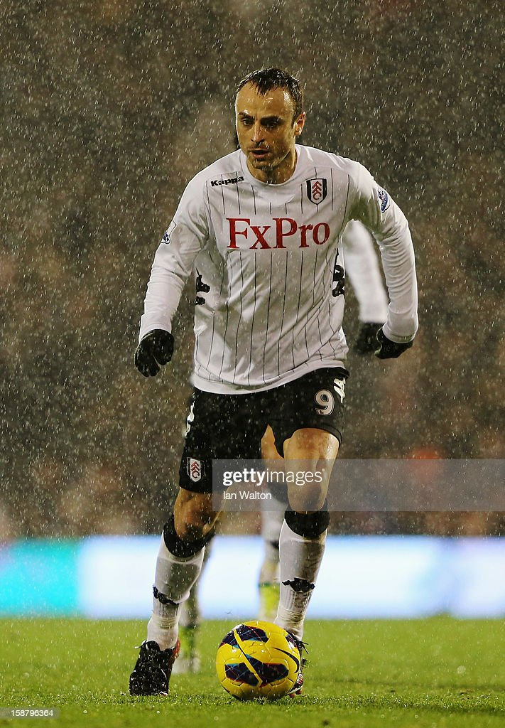 Dimitar Berbatov of Fulham runs with the ball during the Barclays Premier League match between Fulham and Swansea City at Craven Cottage on December 29, 2012 in London, England.
