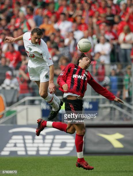Dimitar Berbatov of Leverkusen is challenged by Dariusz Zuraw of Hanover during the Bundesliga match between Hanover 96 and Bayer Leverkusen at the...