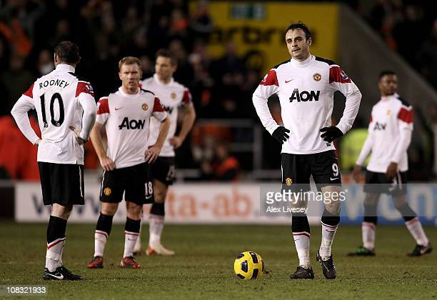 Dimitar Berbatov of Manchester United and his team mates look dejected after conceding a second goal during the Barclays Premier League match between...