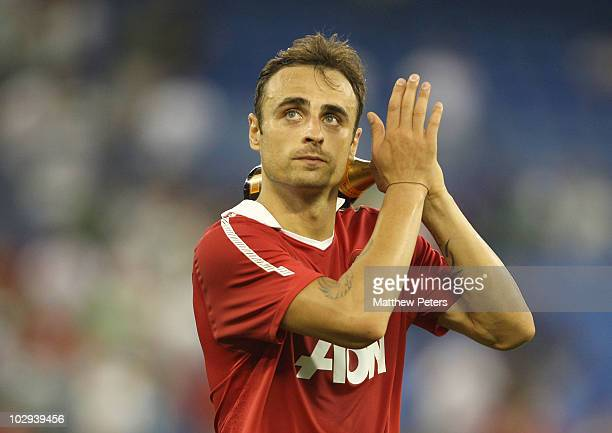 Dimitar Berbatov of Manchester United applauds the fans while holding his Man of the Match award after the preseason friendly match between...