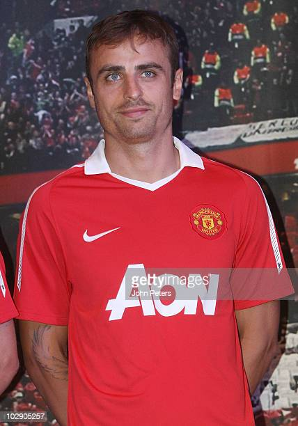 Dimitar Berbatov of Manchester United attends the launch of the new Manchester United home kit featuring new shirt sponsors Aon at NikeTown on July...