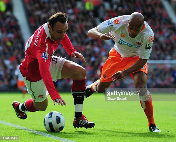 Dimitar Berbatov of Manchester United battles with Alex JohnBaptiste of Blackpool during the Barclays Premier League match between Manchester United...