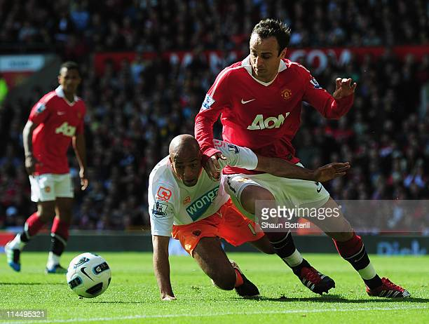 Dimitar Berbatov of Manchester United battles withAlex JohnBaptiste of Blackpool during the Barclays Premier League match between Manchester United...