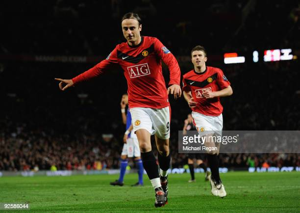 Dimitar Berbatov of Manchester United celebrates scoring the first goal with team mate Michael Carrick during the Barclays Premier League match...