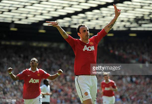 Dimitar Berbatov of Manchester United celebrates scoring the opening goal during the Barclays Premier League match between Manchester United and...