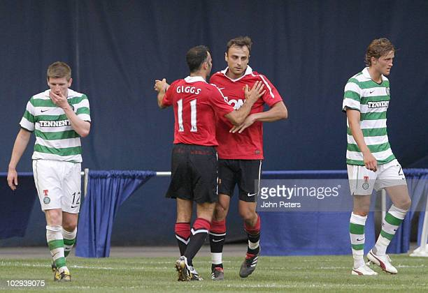 Dimitar Berbatov of Manchester United celebrates scoring their first goal during the preseason friendly against Celtic with Ryan Giggs at Rogers...
