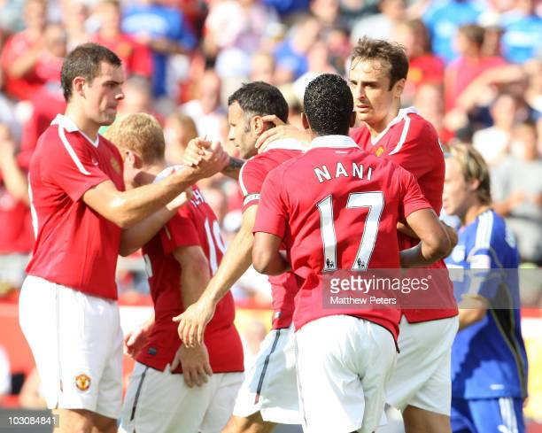 Dimitar Berbatov of Manchester United celebrates scoring their first goal during the preseason friendly match between Kansas CIty Wizards and...