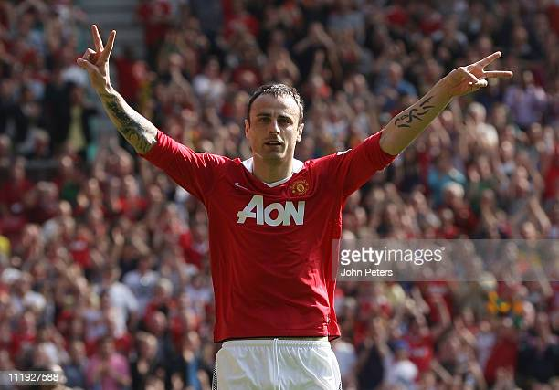 Dimitar Berbatov of Manchester United celebrates scoring their first goal during the Barclays Premier League match between Manchester United and...