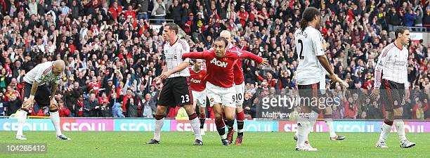 Dimitar Berbatov of Manchester United celebrates scoring their second goal during the Barclays Premier League match between Manchester United and...