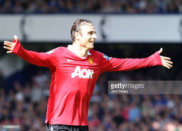 Dimitar Berbatov of Manchester United celebrates scoring their third goal during the Barclays Premier League match between Everton and Manchester...