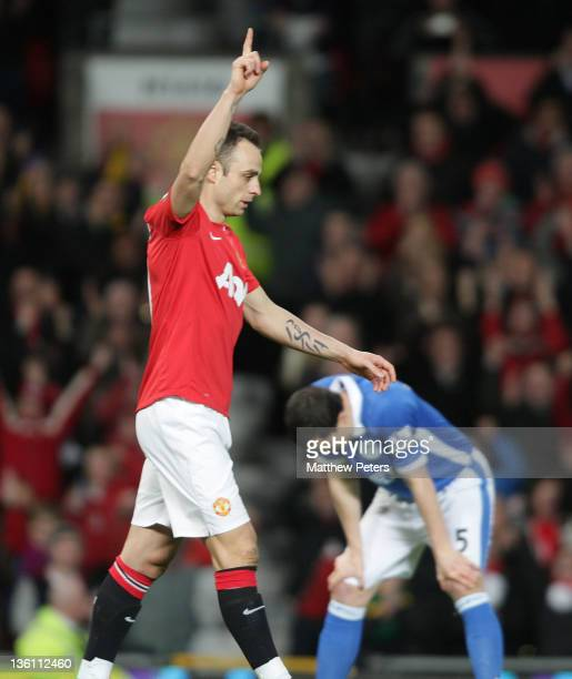 Dimitar Berbatov of Manchester United celebrates scoring their third goal during the Barclays Premier League match between Manchester United and...