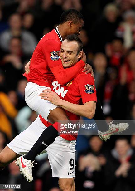 Dimitar Berbatov of Manchester United celebrates scoring with team mate Patrice Evra during the Barclays Premier League match between Manchester...