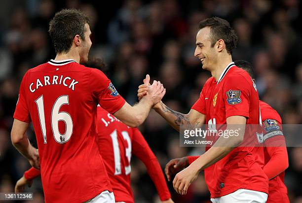 Dimitar Berbatov of Manchester United celebrates scoring with team mate Michael Carrick during the Barclays Premier League match between Manchester...