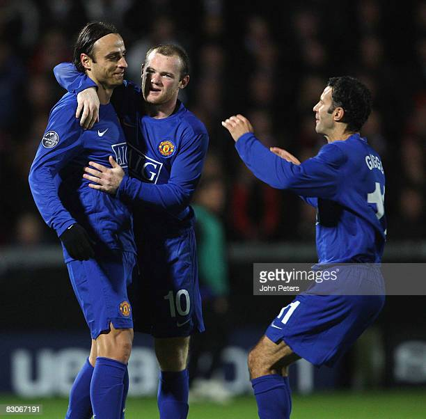 Dimitar Berbatov of Manchester United celebrates with Wayne Rooney and Ryan Giggs after scoring the second goal during the UEFA Champions League...