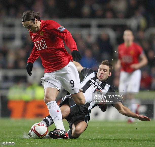 Dimitar Berbatov of Manchester United clashes with Alan Smith of Newcastle United during the Barclays Premier League match between Newcastle United...