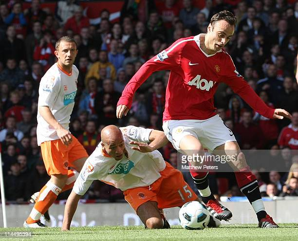 Dimitar Berbatov of Manchester United clashes with Alex Baptiste of Blackpool during the Barclays Premier League match between Manchester United and...