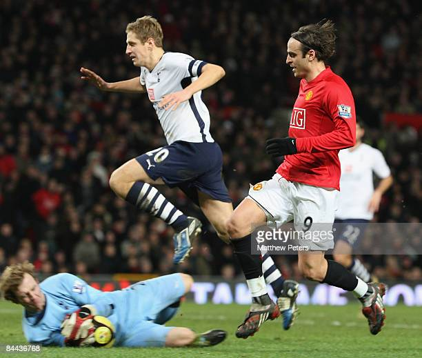 Dimitar Berbatov of Manchester United clashes with Ben Alnwick and Michael Dawson of Tottenham Hotspur during the FA Cup sponsored by eon Fourth...