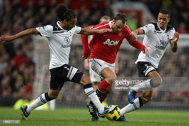 Dimitar Berbatov of Manchester United clashes with Benoit AssouEkotto and Jermaine Jenas of Tottenham Hotspur during the Barclays Premier League...