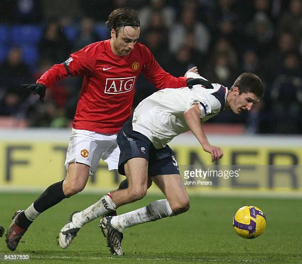 Dimitar Berbatov of Manchester United clashes with Chris Basham of Bolton Wanderers during the Barclays Premier League match between Bolton Wanderers...