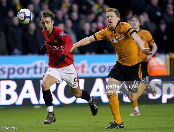 Dimitar Berbatov of Manchester United clashes with Christophe Berra of Wolverhampton Wanderers during the FA Barclays Premier League match between...