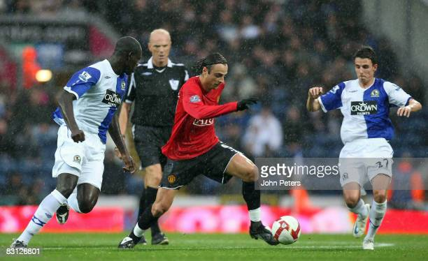 Dimitar Berbatov of Manchester United clashes with Christopher Samba and Matt Derbyshire of Blackburn Rovers during the FA Premier League match...