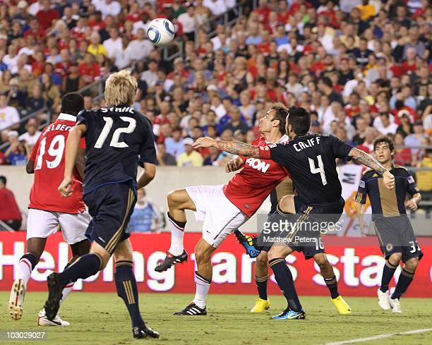 Dimitar Berbatov of Manchester United clashes with Danny Califf of Philadelphia Union during the pre-season friendly match between Philadelphia Union...