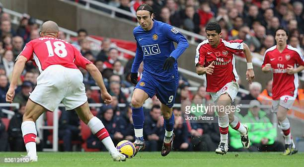 Dimitar Berbatov of Manchester United clashes with Denilson of Arsenal during the Barclays Premier League match between Arsenal and Manchester United...