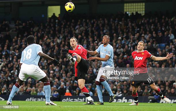 Dimitar Berbatov of Manchester United clashes with Jerome Boateng of Manchester City during the Barclays Premier League match between Manchester City...