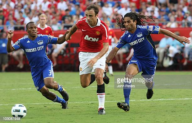 Dimitar Berbatov of Manchester United clashes with Korede Aiyegbusi and Stephane Auvray of Kansas City Wizards during the preseason friendly match...