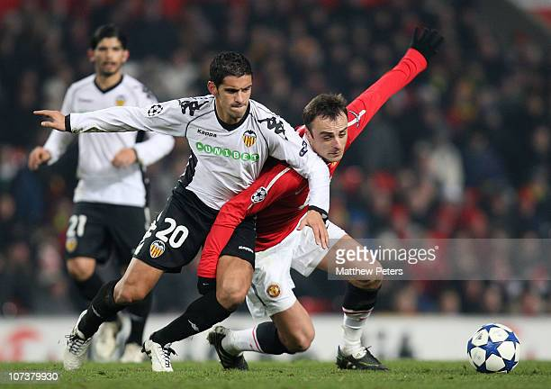 Dimitar Berbatov of Manchester United clashes with Ricardo Costa of Valencia during the UEFA Champions League Group C match between Manchester United...