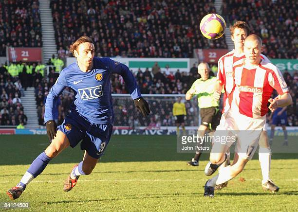 Dimitar Berbatov of Manchester United clashes with Ryan Shawcross of Stoke CIty during the Barclays Premier League match between Stoke City and...