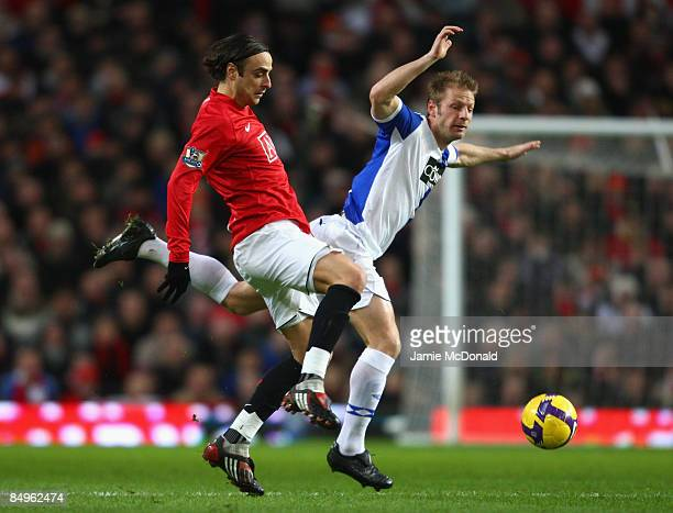 Dimitar Berbatov of Manchester United competes for the ball with Vincenzo Grella of Blackburn Rovers during the Barclays Premier League match between...