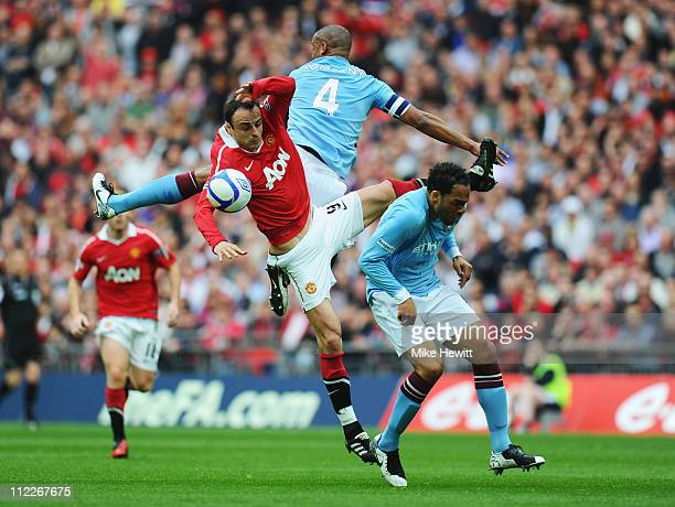 Dimitar Berbatov of Manchester United goes up for the ball with Pablo Zabaleta and Joleon Lescott of Manchester City during the FA Cup sponsored by...