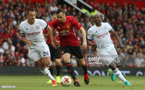 Dimitar Berbatov of Manchester United in action with John Terry of Michael Carrick AllStars during the Michael Carrick Testimonial match between...