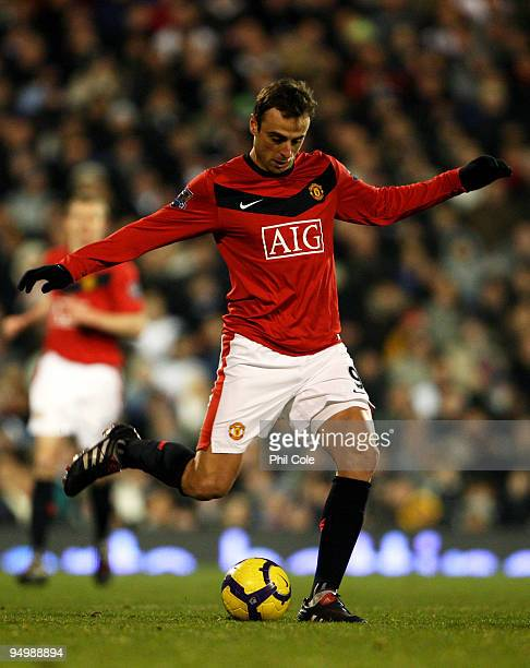 Dimitar Berbatov of Manchester United passes the ball during the Barclays Premier League match between Fulham and Manchester United at Craven Cottage...