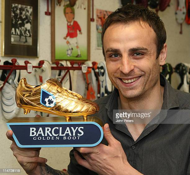 Dimitar Berbatov of Manchester United poses with his Barclays Golden Boot award for being the jointhighest goalscorer in the Barclays Premier League...