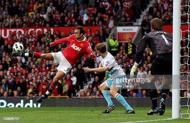Dimitar Berbatov of Manchester United scores his team's third goal during the Barclays Premier League match between Manchester United and West Ham...