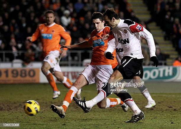 Dimitar Berbatov of Manchester United scores his team's third goal during the Barclays Premier League match between Blackpool and Manchester United...