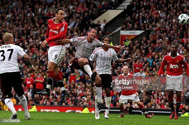 Dimitar Berbatov of Manchester United scores his team's third goal to complete his hattrick during the Barclays Premier League match between...
