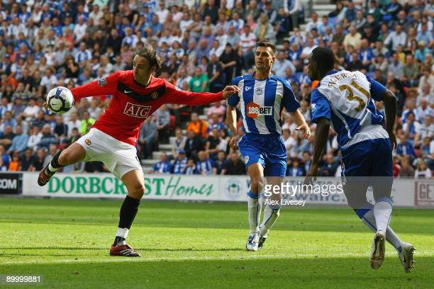 Dimitar Berbatov of Manchester United scores the second goal during the Barclays Premier League match between Wigan Athletic and Manchester United at...