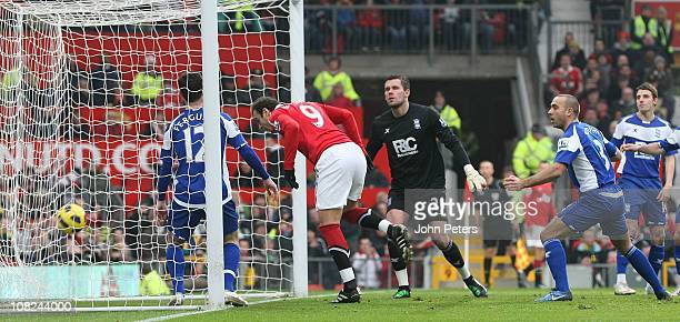 Dimitar Berbatov of Manchester United scores their first goal during the Barclays Premier League match between Manchester United and Birmingham City...