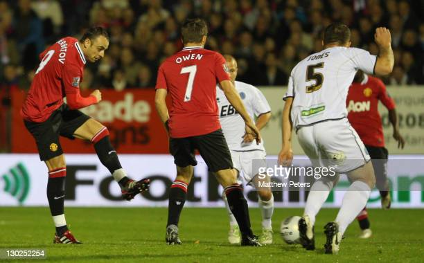 Dimitar Berbatov of Manchester United scores their first goal during the Carling Cup fourth round match between Aldershot Town and Manchester United...