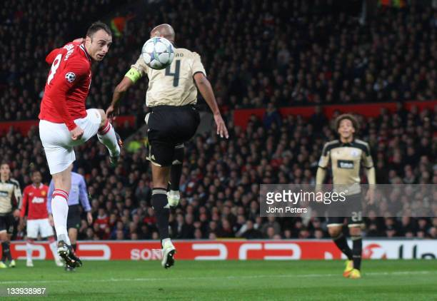 Dimitar Berbatov of Manchester United scores their first goal during the UEFA Champions League Group C match between Manchester United and Benfica at...