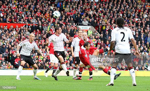 Dimitar Berbatov of Manchester United scores their second goal during the Barclays Premier League match between Manchester United and Liverpool at...