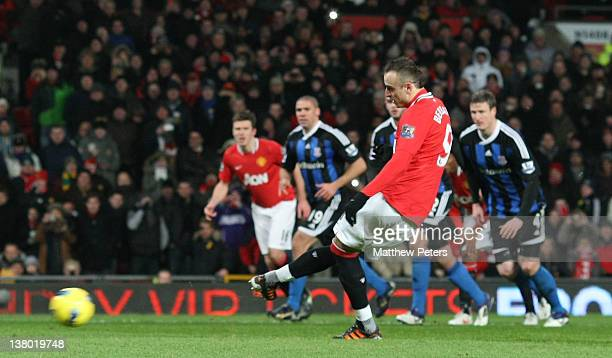 Dimitar Berbatov of Manchester United scores their second goal during the Barclays Premier League match between Manchester United and Stoke City at...