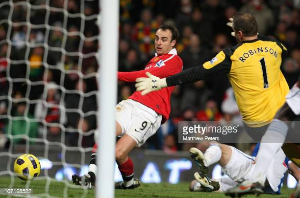 Dimitar Berbatov of Manchester United scores their seventh goal during the Barclays Premier League match between Manchester United and Blackburn...