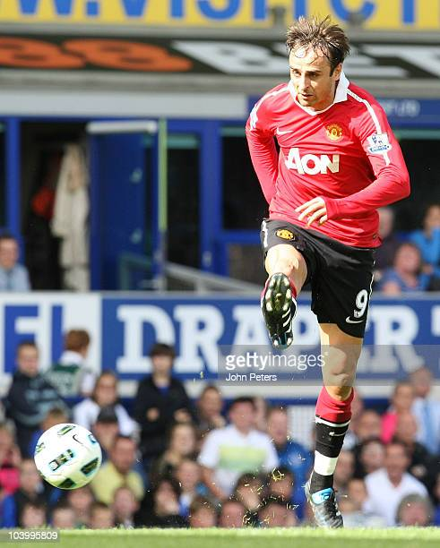 Dimitar Berbatov of Manchester United scores their third goal during the Barclays Premier League match between Everton and Manchester United at...